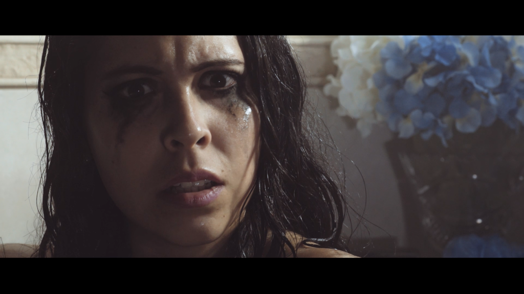 Screen shot of Gigi from her PSA Segment for Women in Horror Month.