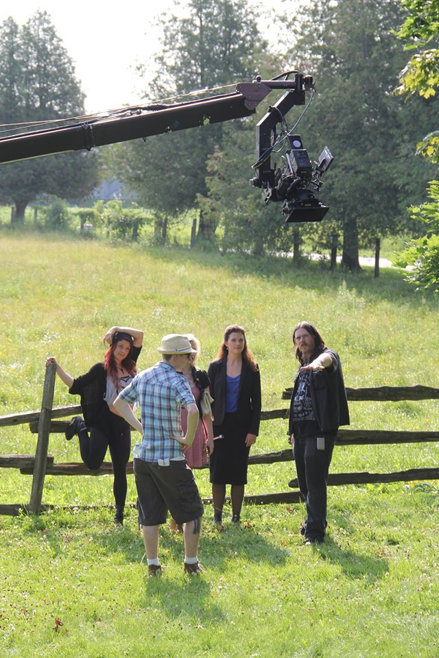 On the set of SAVE YOURSELF, Director Ryan M. Andrews and 1st AD Charles Smith run through a shot with actresses Jessica Cameron, Caleigh Le Grand and Lara Mrkoci.